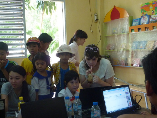 TSC Team teaching how to use the computers