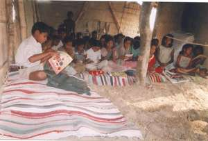 Children using school mat made out of waste cloth