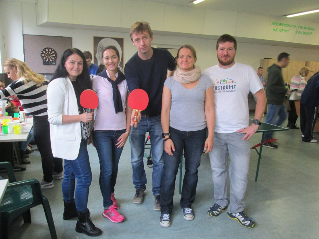 Clients and volunteers before match in ping-pong