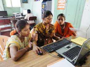 Girls learning Computers