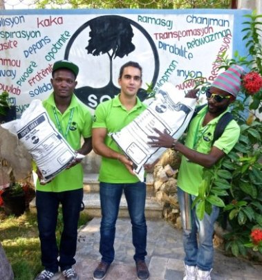 Port-au-Prince SOIL team shows off the new bags