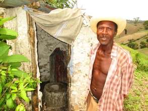 Montas next to his completed latrine.