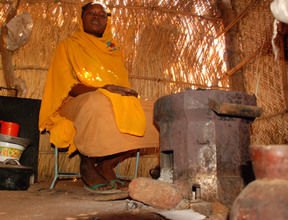 Nafisa with her new stove and chairs.