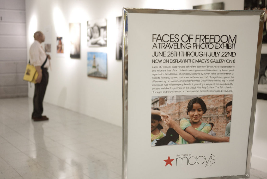 Faces of Freedom signage at Macy