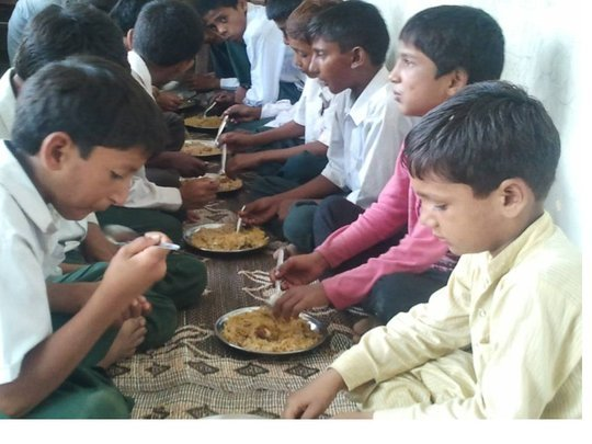 Lunch being served at the Malikpur NUR Foundation