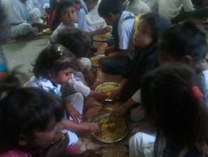 Students enjoying Mutton Biryani at the schools
