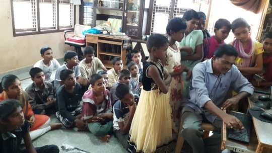 Orphan Children learning computer training india