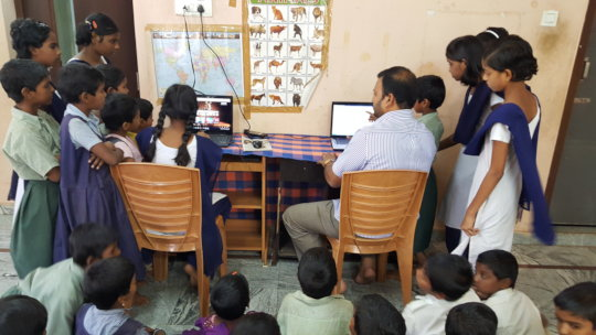 Underprivileged Children learning ComputerTraining