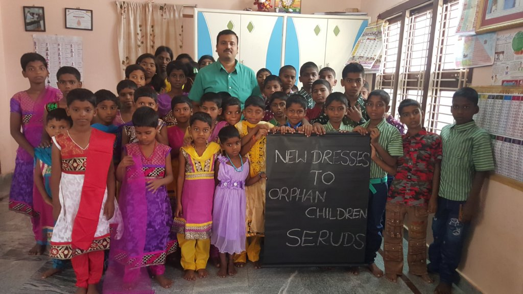 Orphan children getting clothes support from chari