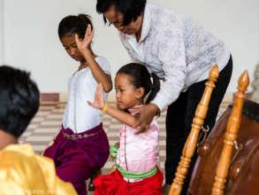 Neark Kru Savorn teaching dance exercises