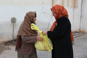 A Elderly Women Receiving Food