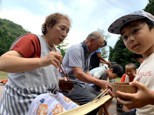 Locals enjoying time with children