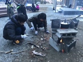 Rocket Project children starting fire to cook rice