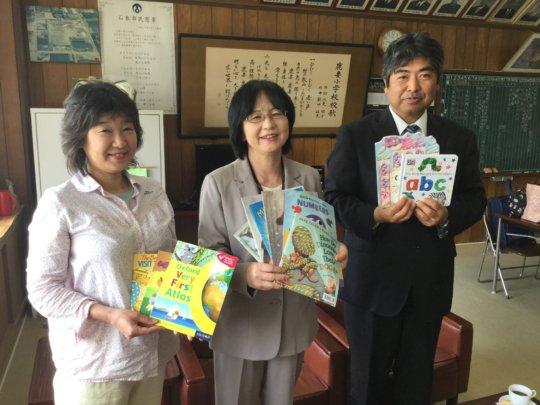Book donation to Kazuma ES Principal