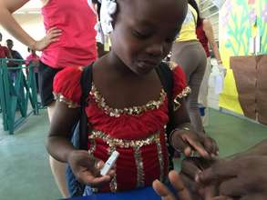 2015 Camp de L'amitie Camper Checking Her Blood