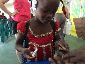 2015 Camp de L'amitie Camper Checking Her Blood