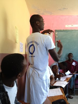 A Haitian young leader explains his drawing