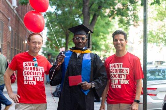 SGSNY Scholar Basiru (center) receives his gift