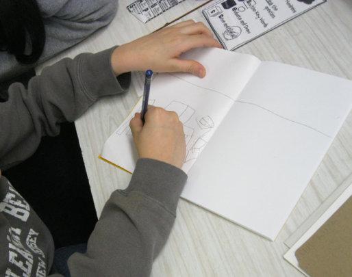PS69 3rd grader sketching Family Storybook