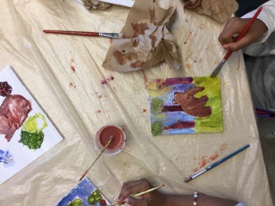 PS163 Visual Arts, student painting a bear