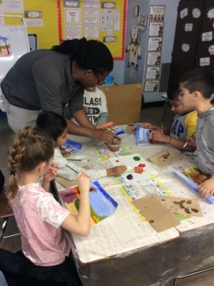 PS69 Teaching Artist helps student with landscape