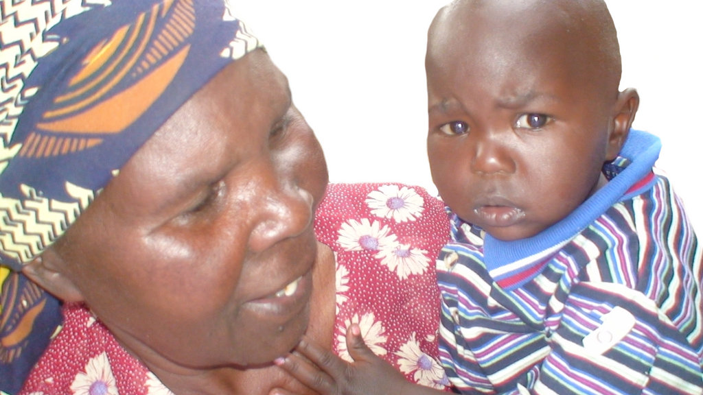 A grandmother cares for her grandchild. Many elderly caregivers are finding themselves in unfamiliar territory when they have to take care of young children after the demise of their parents.