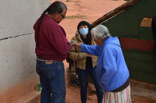 Adrian, helping an elder understand her new system