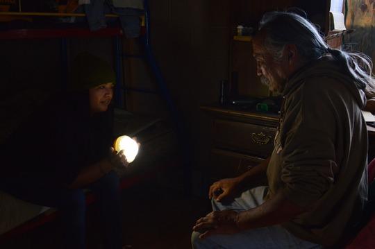 Adrian, teaching a Navajo elder about his light!