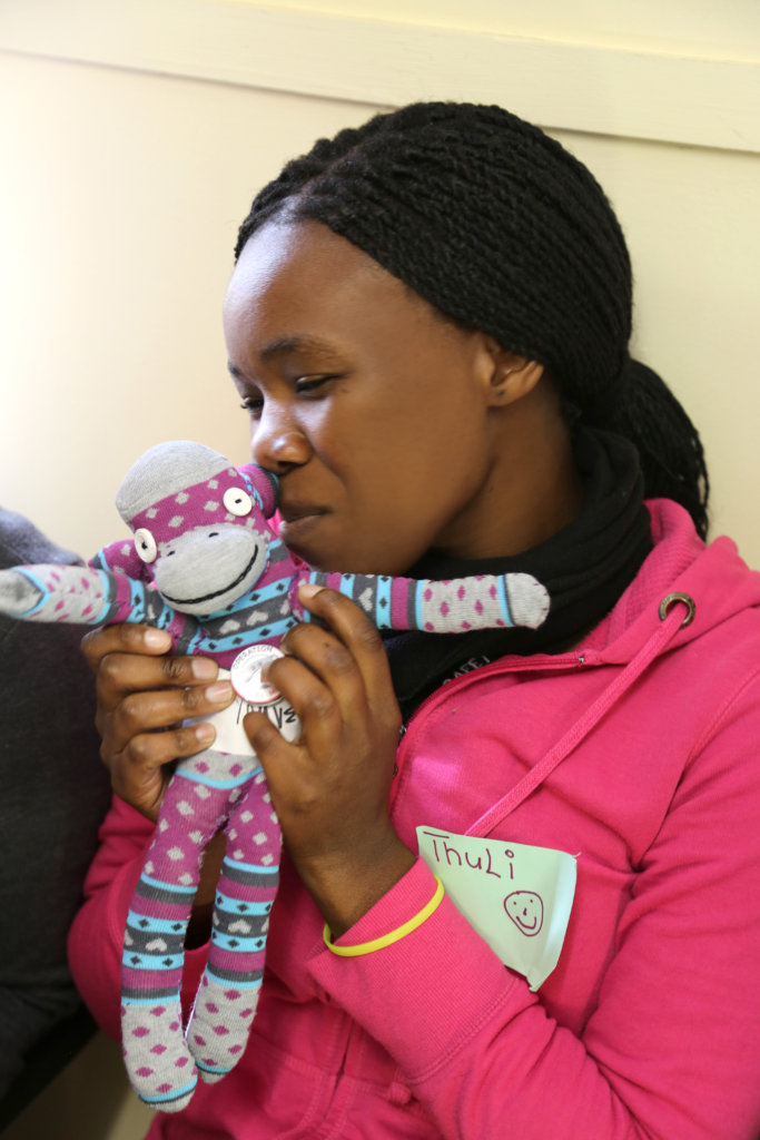 Thuli with her project Sock Monkey.