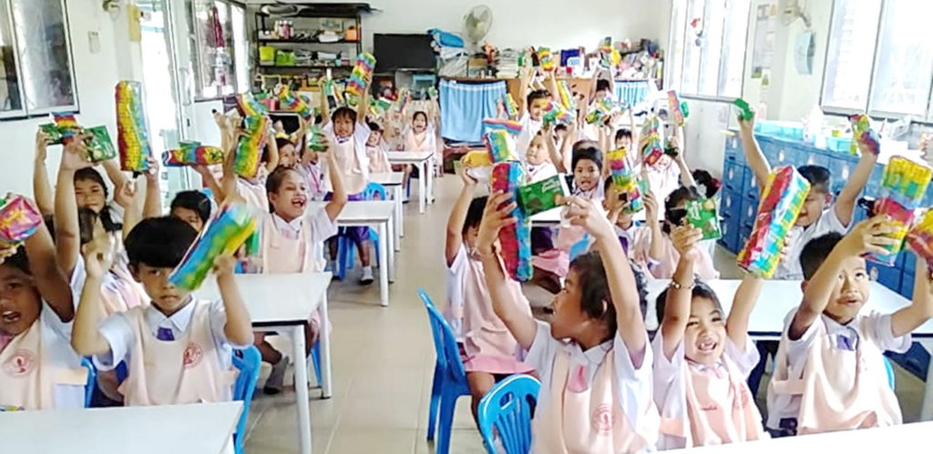Delighted pre-school kids with their gifts