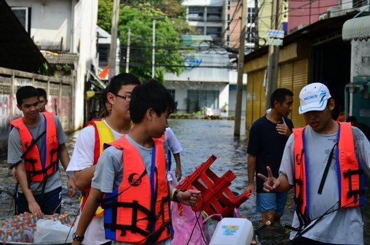 Wading through water to distribute lifepacks
