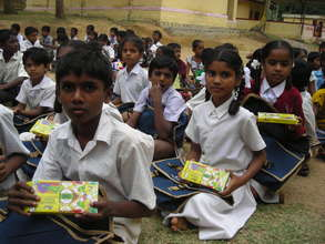 Children with new School Supplies