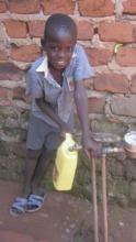 Denis fetching water