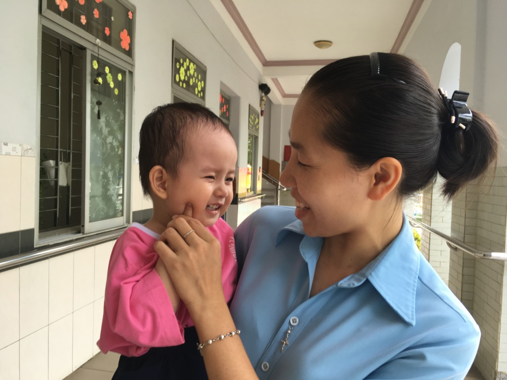 A child in early intervention and her teacher