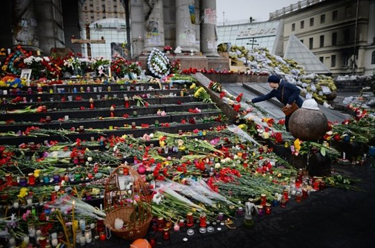Flowers to the memorial for killed activists