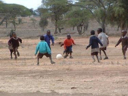 Kids Playing Football with an Alive & Kicking Bal