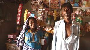 Hema and her husband in their shop