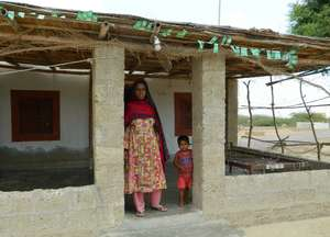 Outside her one-room house