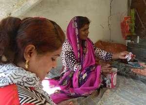 Khursheeda and Mena, a disabled girl she helped