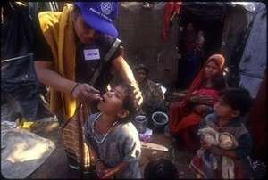 An Indian child is immunized from polio