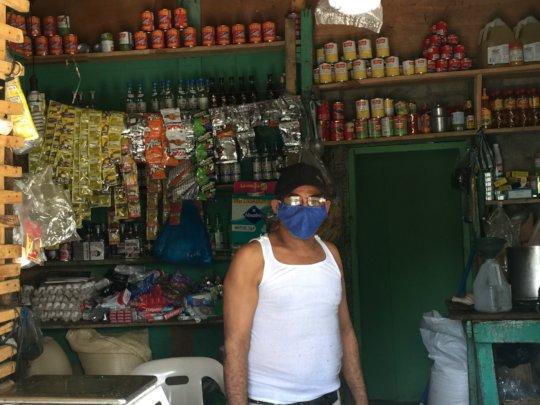 Colmado owner, Fernando, in his community store