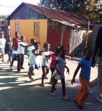 Children enter their new pre-K classroom.