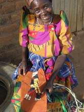 Woman from Katovu showing pride in her fabric coll
