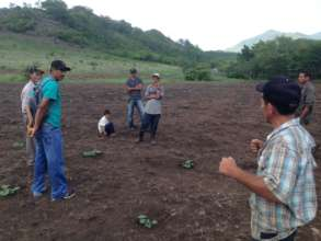 Junior and Jose training men in gardening