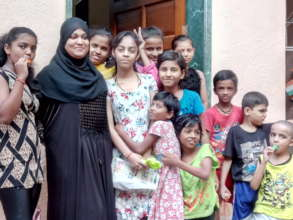 Saleha with Girl Participants and their Siblings