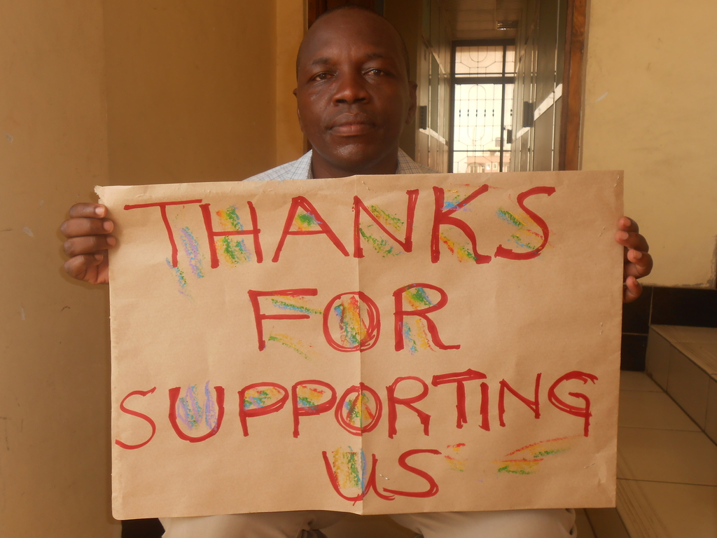 James with a thanks poster