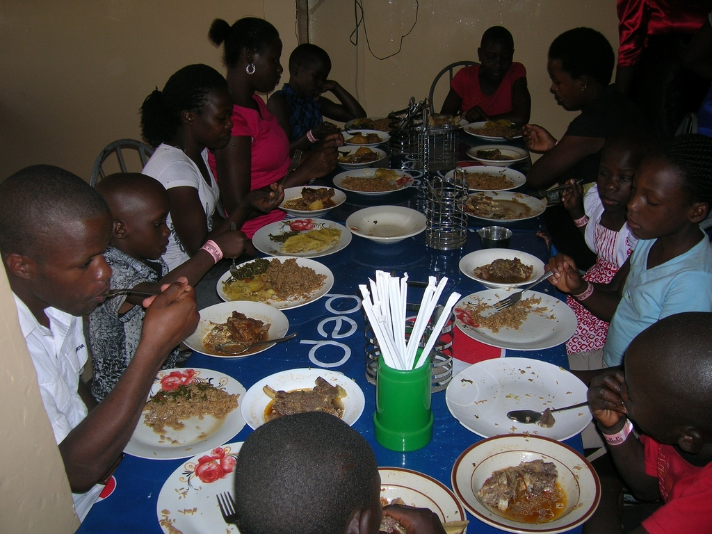Children having a delicious pork meal in a home