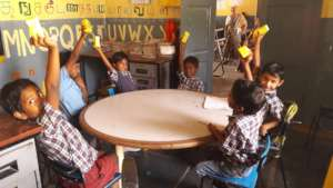 Children enjoying their Saturday snacks