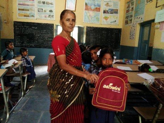 Children getting new school bags