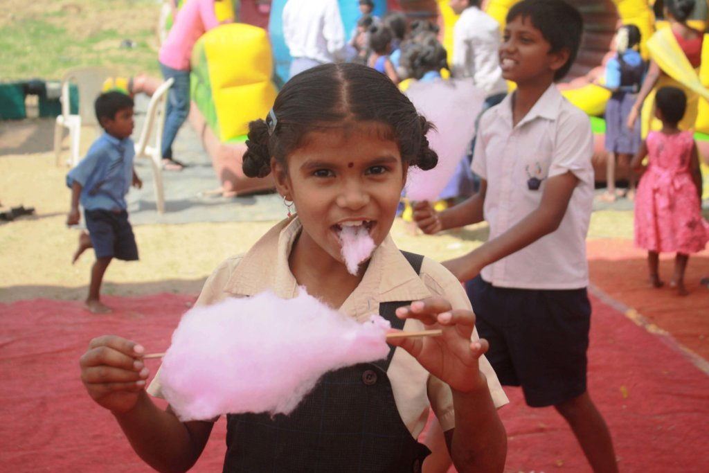 Eating Cotton candy at the christmas celebration